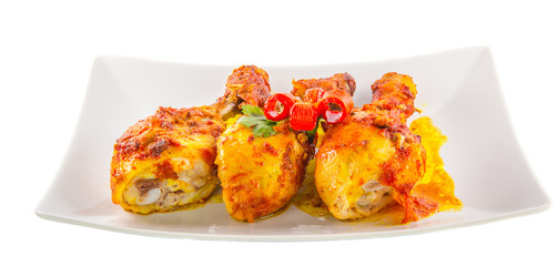 Tandoori chicken in a plate over white background