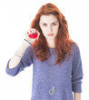 Mad and upset young woman holding red ball