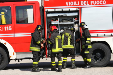 Firefighters prepare for the tools from the truck during a serio