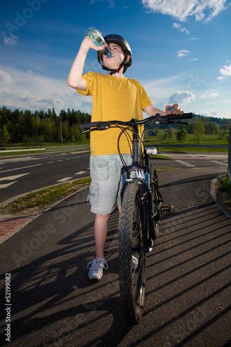 Healthy lifestyle - teenage boy biking