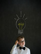 Thinking boy businessman with bright idea chalk lightbulb