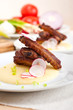 pork ribs on polenta corn cream bed