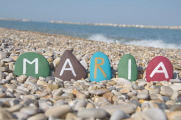 Maria, female name on colourful stones