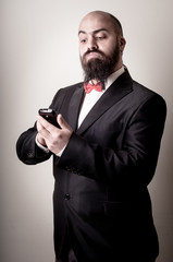 funny elegant bearded man on the phone