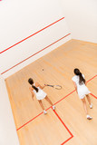 Women playing squash