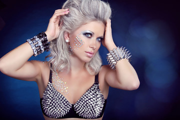 Beautiful rock woman with hair styling and evening make-up. Jewe