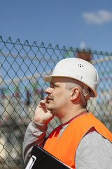 Engineer with a folder in factory site