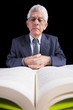 Senior businessman reading a book