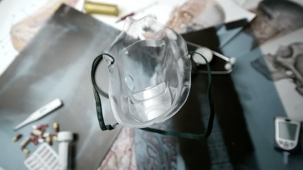 Medical mask falling over medical tools