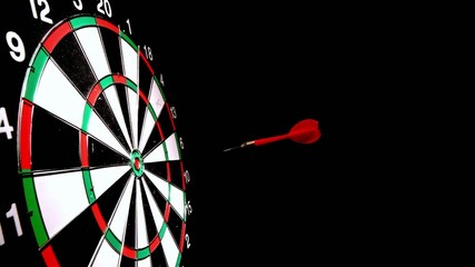 Dart hitting the bulls eye side view