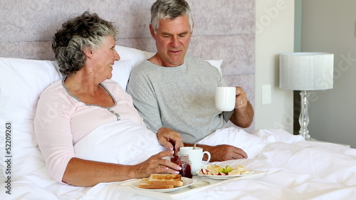 Mature couple having breakfast together