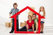 Happy family with kids moving into their new home