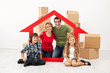 Happy family with kids moving into a new home