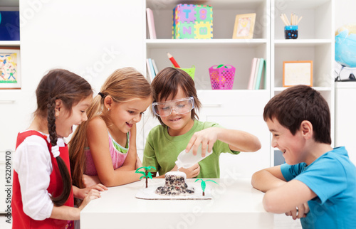 Kids observing a science lab project at home