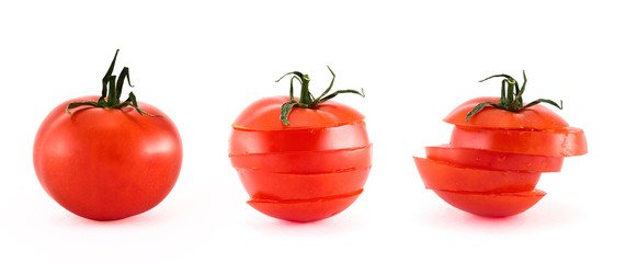 Sliced fresh tomatoes isolated over white