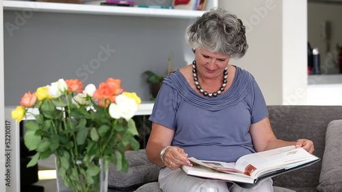 Woman reading a book on the couch