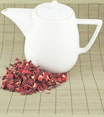 White teapot with red tea