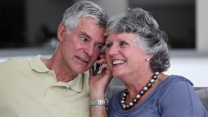 Mature couple having a phone conversation
