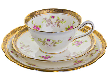 Antique tea cup, saucer and small plate.