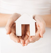 woman hands holding paper house