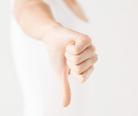 woman showing thumbs down