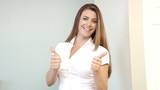Success happy business woman with thumbs up