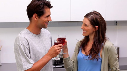 Couple toasting in the kitchen