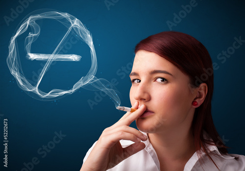 Young lady smoking unhealthy cigarette with no smoking sign