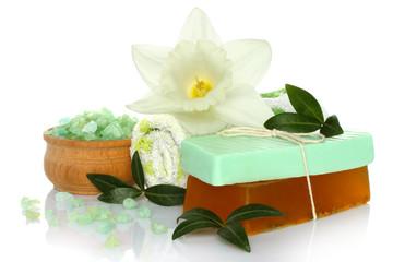 Spa composition of handmade soap, towel, flower and salt