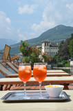 Traditional Italian Spritz cocktail against lake Como, Italy