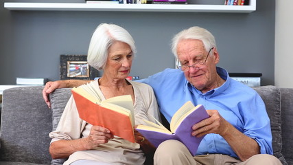 Elderly couple reading books