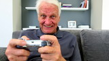 Old man playng video games