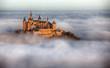 Leinwandbild Motiv Burg Hohenzollern über den Wolken
