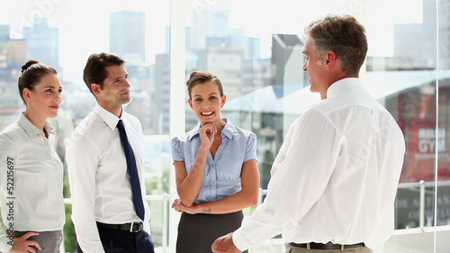 Business man speaking with colleagues