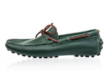 Dark-green female loafer over white