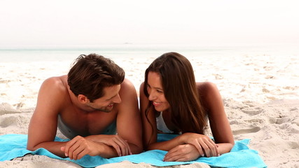 Couple laughing together on the beach