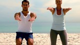 Friends doing pilates on the beach together