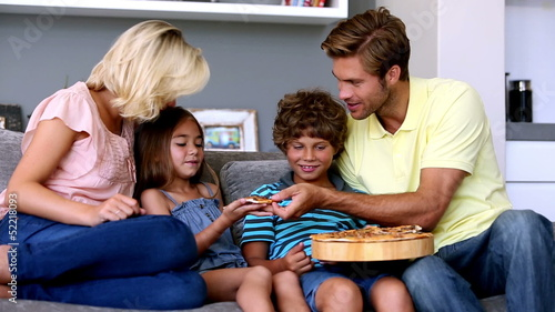Family having pizza together