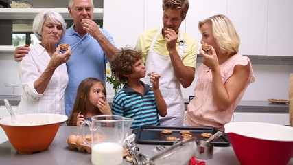 Family eating freshly baked homemade cookies