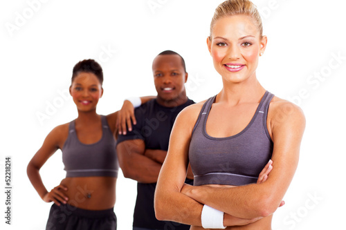 happy sporty woman with arms folded
