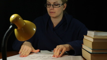 Frustrated woman folding paper