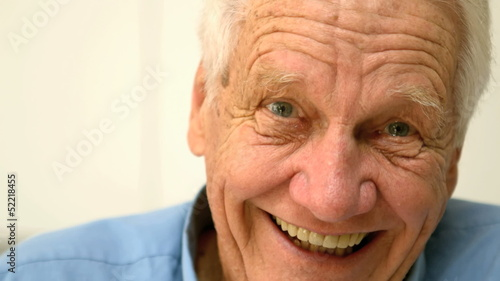 Cheerful old man laughing