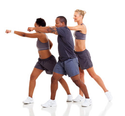 group of people exercising karate