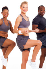 caucasian woman exercising with two friends