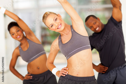 personal trainer exercise with two friends - 52219002