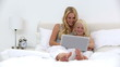 Mother and daughter using laptop together