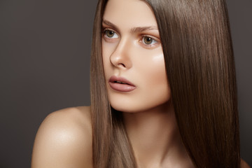 Woman model with shiny straight long blond hair, make-up