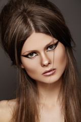Fashion woman with chic hairstyle, liner on eyes make-up