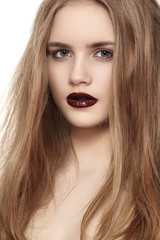 Portrait of young fashion woman with dark red lips makeup