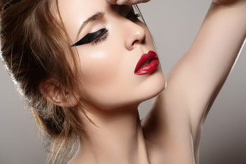 Woman model with glamour red lips make-up, hairstyle